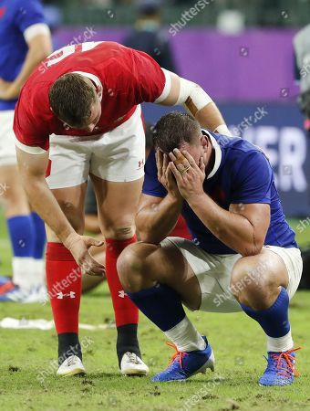 Liam Williams of Wales (L) and Louis Picamoles of France (R) react after the Rugby World Cup quarter-final match between Wales and France in Oita, Japan, 20 October 2019.