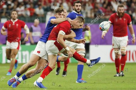 Liam Williams of Wales (R) is tackled by Damian Penaud of France (L) during the Rugby World Cup quarter-final match between Wales and France in Oita, Japan, 20 October 2019.
