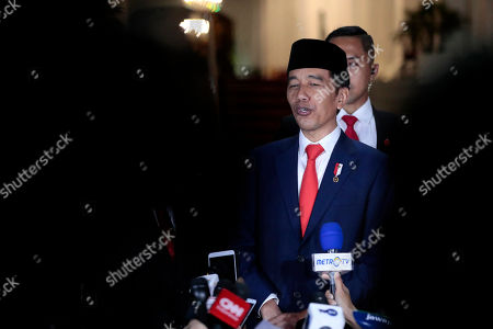 Indonesian President Joko Widodo speaks to the media upon arrival from his inauguration for his second term, at Merdeka Palace in Jakarta, Indonesia, . Indonesian President Joko Widodo, who rose from poverty and pledged to champion democracy, fight entrenched corruption and modernize the world's most populous Muslim-majority nation, was sworn in Sunday for his second and final five-year term with a pledge to take bolder actions