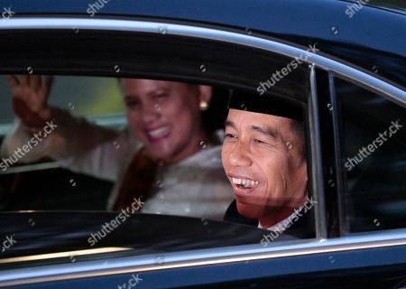 Stock Picture of Indonesian President Joko Widodo smiles at the media upon arrival after his inauguration for his second term, at Merdeka Palace in Jakarta, Indonesia, . Widodo, who rose from poverty and pledged to champion democracy, fight entrenched corruption and modernize the world's most populous Muslim-majority nation, was sworn in Sunday for his second and final five-year term with a pledge to take bolder actions