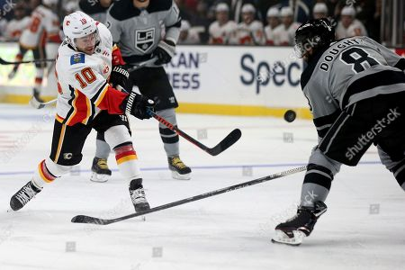 Calgary Flames center Derek Ryan (10) takes a shot against the Los Angeles Kings defenseman Drew Doughty (8) during the first period of an NHL hockey game in Los Angeles