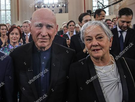 Brazilian author Sebastiao Salgado (L) accompanied by his wife Lelia Wanick Salgado during the Peace Prize of the German Book Trade ceremony in Frankfurt Main, Germany, 20 October 2019. Sebastiao Salgado is awarded with the Peace Prize of the German Book Trade by the German Publishers and Booksellers Association (Boersenverein des Deutschen Buchhandels) on the sidelines of the Frankfurt Book Fair.  He won the German book trade Peace Prize for raising awareness about environmental destruction and the climate crisis.