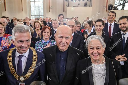 Brazilian author Sebastiao Salgado (C) accompanied by his wife Lelia Wanick Salgado (R) and Lord Mayor of Frankfurt Peter Feldmann (L) during the Peace Prize of the German Book Trade ceremony in Frankfurt Main, Germany, 20 October 2019. Sebastiao Salgado is awarded with the Peace Prize of the German Book Trade by the German Publishers and Booksellers Association (Boersenverein des Deutschen Buchhandels) on the sidelines of the Frankfurt Book Fair.  He won the German book trade Peace Prize for raising awareness about environmental destruction and the climate crisis.