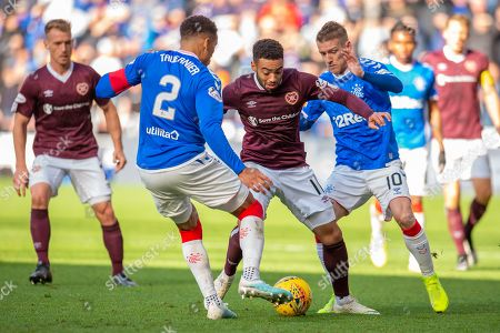 Jake Mulraney (#11) of Heart of Midlothian FC is closed down by James Tavernier (#2) of Rangers FC and Steven Davis (#10) of Rangers FC during the Ladbrokes Scottish Premiership match between Heart of Midlothian and Rangers FC at Tynecastle Park, Edinburgh