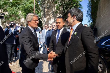 United Arab Emirates Foreign Minister, Sheikh Abdullah bin Zayed Al Nahyan (R), is welcomed by Italian Foreign Minister Luigi Di Maio (C) and Italian Government's Commissioner General for Expo 2020 Dubai, Paolo Glisenti (L), upon his arrival at the 'One Year to Go' event in Matera, southern Italy, 20 October 2019. The event represents a symbolic passing of the torch from Expo Milano 2015 and Expo Dubai 2020, at exactly one year from its opening. Expo Dubai 2020, which will run from 20 October 2020 to 10 April 2021, will be dedicated to the theme 'Connecting Minds, Creating the Future'.