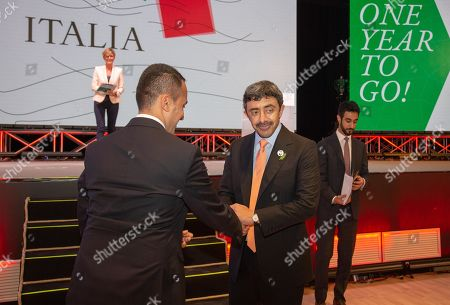 Stock Photo of Italian Foreign Minister Luigi Di Maio (L) shakes hands with United Arab Emirates Foreign Minister Sheikh Abdullah bin Zayed Al Nahyan, at the 'One Year to Go' event in Matera, southern Italy, 20 October 2019. The event represents a symbolic passing of the torch from Expo Milano 2015 and Expo Dubai 2020, at exactly one year from its opening. Expo Dubai 2020, which will run from 20 October 2020 to 10 April 2021, will be dedicated to the theme 'Connecting Minds, Creating the Future'.