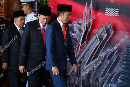 Indonesian President Joko Widodo (R), People Consultative Assembly (MPR) speaker Bambang Soesatyo (C) and vice president Jusuf Kalla (L) arrive at the House of Representatives in Jakarta, Indonesia, 20 October 2019. President Joko Widodo will be sworn in for his second five years term in the capital amid tight security.