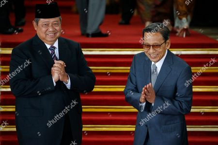 Former Indonesian President Susilo Bambang Yudhoyono and his Vice President Boediono react to journalists as they arrive to attend the president Joko Widodo's inauguration for the second term, at the House of Representative building in Jakarta, Indonesia 20 October 2019. President Joko Widodo sworn in for his second five years term in the capital amid tight security with 30,000 soldiers and police standing guard.
