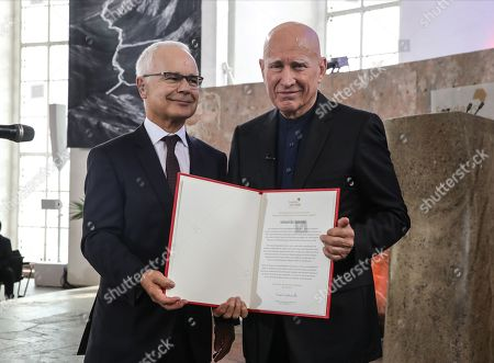 Brazilian photographer and author Sebastiao Salgado (R) receive from Heinrich Riethmueller, chair of the German Publishers and Booksellers Association the award Peace Prize of the German Book Trade in Frankfurt Main, Germany, 20 October 2019. Sebastiao Salgado is awarded with the Peace Prize of the German Book Trade by the German Publishers and Booksellers Association (Boersenverein des Deutschen Buchhandels) on the sidelines of the Frankfurt Book Fair.  He won the German book trade Peace Prize for raising awareness about environmental destruction and the climate crisis
