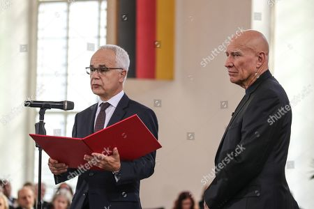Brazilian photographer and author Sebastiao Salgado (R)  receives from Heinrich Riethmueller (L), chair of the German Publishers and Booksellers Association the award Peace Prize of the German Book Trade  in Frankfurt Main, Germany, 20 October 2019. Sebastiao Salgado is awarded with the Peace Prize of the German Book Trade by the German Publishers and Booksellers Association (Boersenverein des Deutschen Buchhandels) on the sidelines of the Frankfurt Book Fair.  He won the German book trade Peace Prize for raising awareness about environmental destruction and the climate crisis