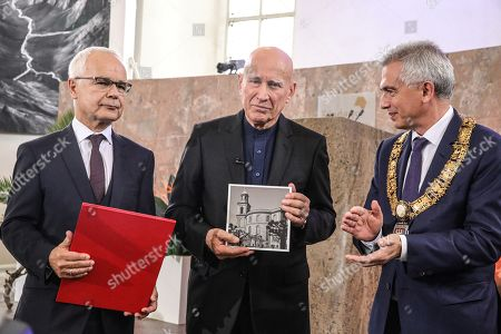 Brazilian photographer and author Sebastiao Salgado (C) after receiving from Heinrich Riethmueller (L), chair of the German Publishers and Booksellers Association the award Peace Prize of the German Book Trade and Mayor of Frankfurt Peter Feldmann (R) here in Frankfurt Main, Germany, 20 October 2019. Sebastiao Salgado is awarded with the Peace Prize of the German Book Trade by the German Publishers and Booksellers Association (Boersenverein des Deutschen Buchhandels) on the sidelines of the Frankfurt Book Fair.  He won the German book trade Peace Prize for raising awareness about environmental destruction and the climate crisis