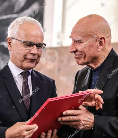 Brazilian photographer and author Sebastiao Salgado (R) receive from Heinrich Riethmueller, chair of the German Publishers and Booksellers Association the award Peace Prize of the German Book Trade in Frankfurt Main, Germany, 20 October 2019. Sebastiao Salgado is awarded with the Peace Prize of the German Book Trade by the German Publishers and Booksellers Association (Boersenverein des Deutschen Buchhandels) on the sidelines of the Frankfurt Book Fair.  He won the German book trade Peace Prize for raising awareness about environmental destruction and the climate crisis.