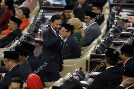 Sultan of Brunei, Hassanal Bolkiah (C) greets Indonesian parliament members during the  inauguration ceremony of President Joko Widodo, at the Parliementary building in Jakarta, Indonesia, 20 October 2019. Joko Widodo was sworn in for his second and final term after winning the April 2019 presidential elections.