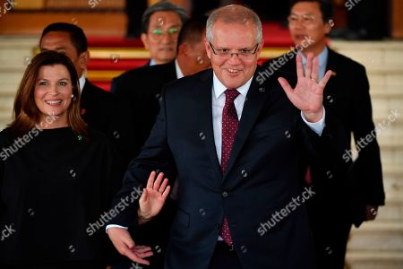 Scott Morrison, Jenifer Morrison. Australia's Prime Minister Scott Morrison and his wife Jennifer, left, gesture towards journalists after the inauguration ceremony of Indonesia President Joko Widodo and Vice President Ma'ruf Amin at the parliament building in Jakarta, Indonesia
