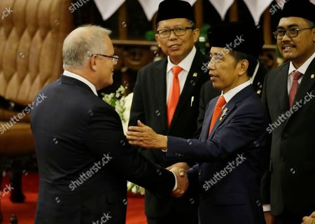 Stock Picture of Scott Morrison, Joko Widodo. Australian Prime Minister Scott Morrison, left, shake hands with Indonesian President Joko Widodo after the inauguration ceremony at the parliament building in Jakarta, Indonesia
