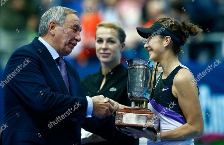 Belinda Bencic, Shamil Tarpischev, Anastasia Pavlyuchenkova. Russian Tennis Federation President Shamil Tarpischev awards Belinda Bencic of Switzerland after her victory over Anastasia Pavlyuchenkova of Russia, centre, in the final match of the Kremlin Cup tennis tournament in Moscow, Russia
