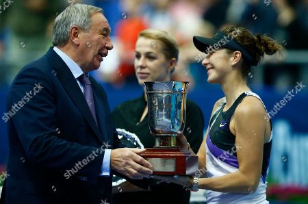 Belinda Bencic, Shamil Tarpischev. Russian Tennis Federation President Shamil Tarpischev awards Belinda Bencic of Switzerland after her victory over Anastasia Pavlyuchenkova of Russia in the final match of the Kremlin Cup tennis tournament in Moscow, Russia