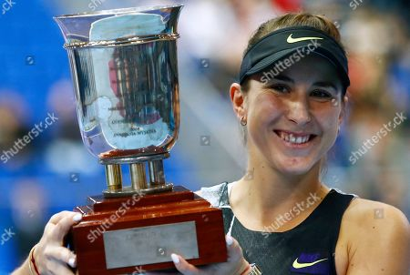 Belinda Bencic of Switzerland holds her trophy after victory over Anastasia Pavlyuchenkova of Russia in the final match of the Kremlin Cup tennis tournament in Moscow, Russia