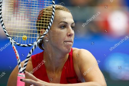 Anastasia Pavlyuchenkova of Russia returns against Belinda Bencic of Switzerland during the final match of the Kremlin Cup tennis tournament in Moscow, Russia