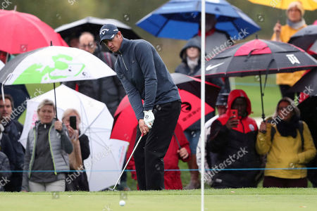 Nicolas Colsaerts of Belgium looks his ball on a green during the last day of the Amundi French Open, at Le Golf National in Saint-Quentin-en-Yvelines, outside Paris, France
