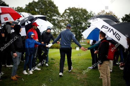 Nicolas Colsaerts of Belgium cheers spectators as he walks to the 4th hole during the last day of the Amundi French Open, at Le Golf National in Saint-Quentin-en-Yvelines, outside Paris, France
