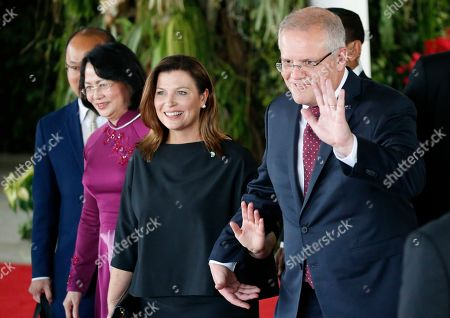 Australian Prime Minister Scott Morrison (R) and his wife Jennifer Morrison (2-R) wave to journalists after attending the inauguration of Indonesia President Joko Widodo for the second term, at the House of Representative building in Jakarta, Indonesia 20 October 2019. President Joko Widodo was sworn in for his second five years term in the capital amid tight security with 30,000 soldiers and police on guard.