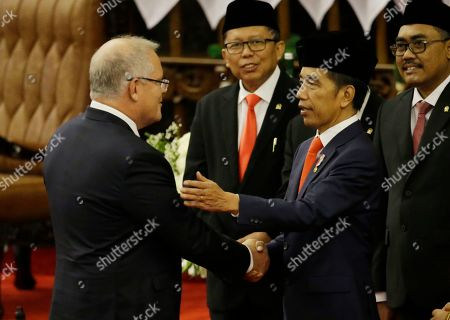 Australian Prime Minister Scott Morrison (L) congratulates Indonesian President Joko Widodo (R), after he was sworn in as President at the parliament building in Jakarta, Indonesia, 20 October 2019. President Joko Widodo was sworn in for his second five years term in the capital amid tight security with 30,000 soldiers and police on guard.