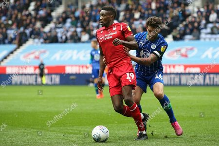 Nottingham Forest forward Sammy Ameobi (19) holds off the challenge from Wigan Athletic defender Charlie Mulgrew (16)  during the EFL Sky Bet Championship match between Wigan Athletic and Nottingham Forest at the DW Stadium, Wigan