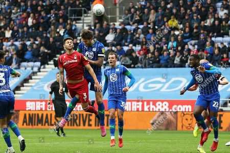 Stock Image of Nottingham Forest defender Tobias Figueiredo (3) beats Wigan Athletic defender Charlie Mulgrew (16) in the air during the EFL Sky Bet Championship match between Wigan Athletic and Nottingham Forest at the DW Stadium, Wigan