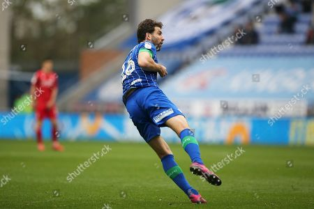 Wigan Athletic defender Charlie Mulgrew (16) hits the post with his free kick during the EFL Sky Bet Championship match between Wigan Athletic and Nottingham Forest at the DW Stadium, Wigan