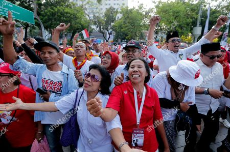 Stock Image of Supporters celebrate as they watch a live broadcast of the swearing-in ceremony of Indonesian President Joko Widodo in Jakarta, Indonesia, . Indonesian President Joko Widodo, who rose from poverty and pledged to champion democracy, fight entrenched corruption and modernise the world's most populous Muslim-majority nation, was sworn in Sunday for his second and final five-year term with a pledge to take bolder actions