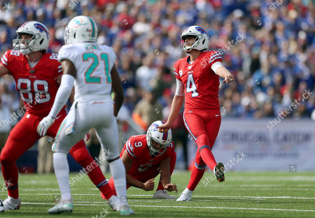 Buffalo Bills kicker Stephen Hauschka, right, follows through on a successful field goal attempt in the first half of an NFL football game Miami Dolphins, in Orchard Park, N.Y