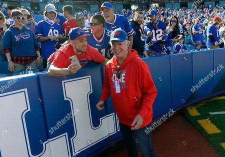Fans cheer actor Christopher McDonald as he walks on the field before an NFL football game between the Buffalo Bills and the Miami Dolphins, in Orchard Park, N.Y