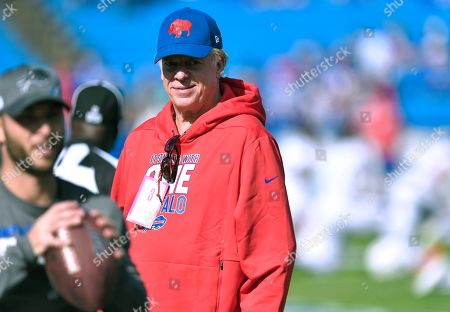 Actor Christopher McDonald watches as the teams as they warm up before an NFL football game between the Buffalo Bills and the Miami Dolphins, in Orchard Park, N.Y