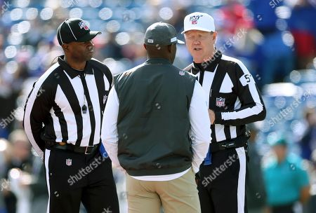 Stock Picture of Side judge Eugene Hall, left, and referee Carl Cheffers, right, speak to Miami Dolphins head coach Brian Flores before an NFL football game between the Dolphins and the Buffalo Bills, in Orchard Park, N.Y