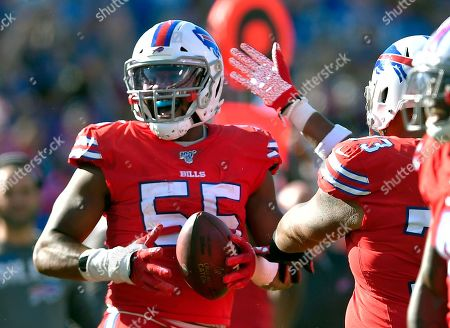 Stock Picture of Buffalo Bills defensive end Jerry Hughes celebrates after recovering a fumble by Miami Dolphins wide receiver Preston Williams in the second half of an NFL football game, in Orchard Park, N.Y