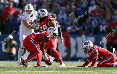 Buffalo Bills defensive end Jerry Hughes recovers a fumble by Miami Dolphins wide receiver Preston Williams in the second half of an NFL football game, in Orchard Park, N.Y