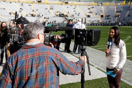 CBS reporter Tracy Wolfson is seen at Lambeau Field before an NFL football game between the Green Bay Packers and the Oakland Raiders, in Green Bay, Wis