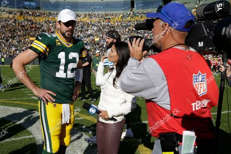 CBS reporter Tracy Wolfson talks to Green Bay Packers' Aaron Rodgers after an NFL football game against the Oakland Raiders, in Green Bay, Wis. The Packers won 42-24