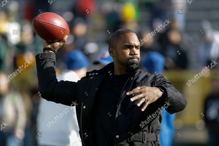 Former Green Bay Packers and Oakland Raiders Charles Woodson is seen before an NFL football game, in Green Bay, Wis
