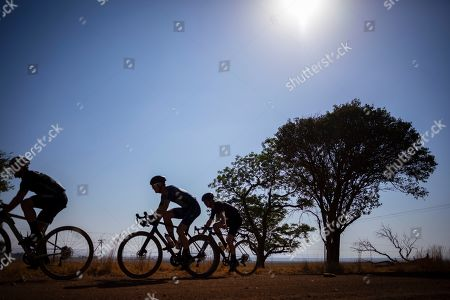 The three leaders and eventual podium racers (L-R) Craig Uria, Dusty Day, and Luke Roberts ride together on a section of fast gravel road during the inaugural SouthxSoutheast gravel fondo bicycle race on the open dirt roads south of Johannesburg, South Africa, 20 October 2019. South Africa has 450,000km of dirt roads and the popularity of the relatively new cycling discipline of gravel racing is ideally suited to the country.