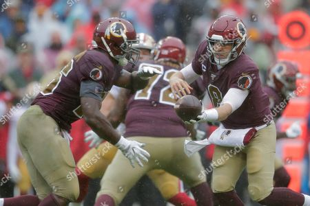 Week 13. Washington Redskins quarterback Case Keenum, right, hands off to Washington Redskins running back Adrian Peterson in the first half of an NFL football game against the San Francisco 49ers, in Landover, Md