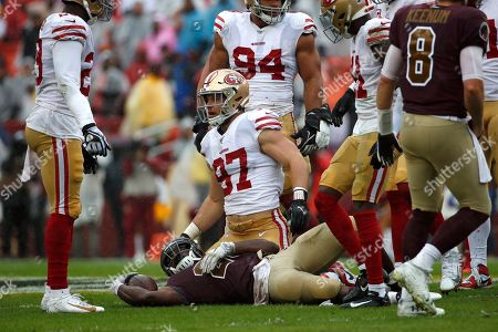 Week 13. San Francisco 49ers defensive end Nick Bosa (97) gets up after tackling Washington Redskins running back Adrian Peterson in the first half of an NFL football game, in Landover, Md