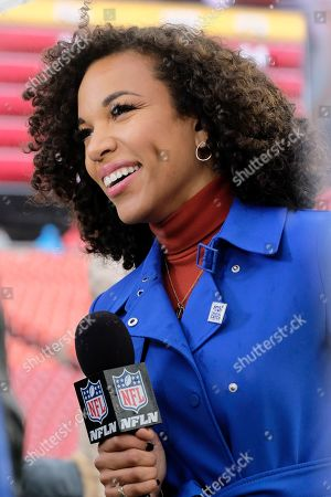 Stock Image of NFL Network personality MJ Acosta broadcasts from the sideline prior to an NFL football game between the San Fransisco 49ers and Washington Redskins, in Landover, Md