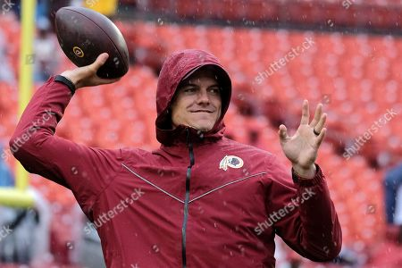 Washington Redskins offensive coordinator Kevin O'Connell throws a football prior to an NFL football game between the San Fransisco 49ers and Washington Redskins, in Landover, Md