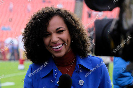 Week 13. Televison presenter MJ Acosta stands on the field before an NFL football game between the San Francisco 49ers and the Washington Redskins, in Landover, Md