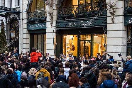Stock Picture of People take pictures with their mobile phones as US actress Angelina Jolie (unseen) leaves a shop of French perfumer Guerlain on the Champs-Elysees in Paris, France, 20 October 2019.