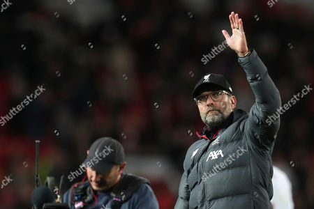 Liverpool's manager Jurgen Klopp greets supporters at the end of the English Premier League soccer match between Manchester United and Liverpool at the Old Trafford stadium in Manchester, England