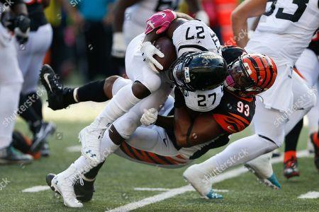 Andrew Brown, Leonard Fournette. Cincinnati Bengals defensive tackle Andrew Brown (93) tackles Jacksonville Jaguars running back Leonard Fournette (27) in the second half of an NFL football game, in Cincinnati