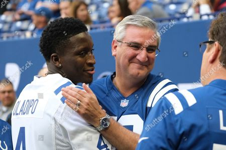 Stock Picture of Indiana Pacers' Victor Oladipo talks with Indiana Gov. Eric Holcomb before an NFL football game between the Indianapolis Colts and the Houston Texans, in Indianapolis